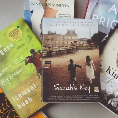 Books about tragedy to build your empathy, including Sarah's Key, A Long Way Gone, Kindred, As Bright As Heaven, Nineteen Minutes.