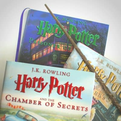 Covers of illustrated Harry Potter books. On reading the Harry Potter series aloud with my daughter.